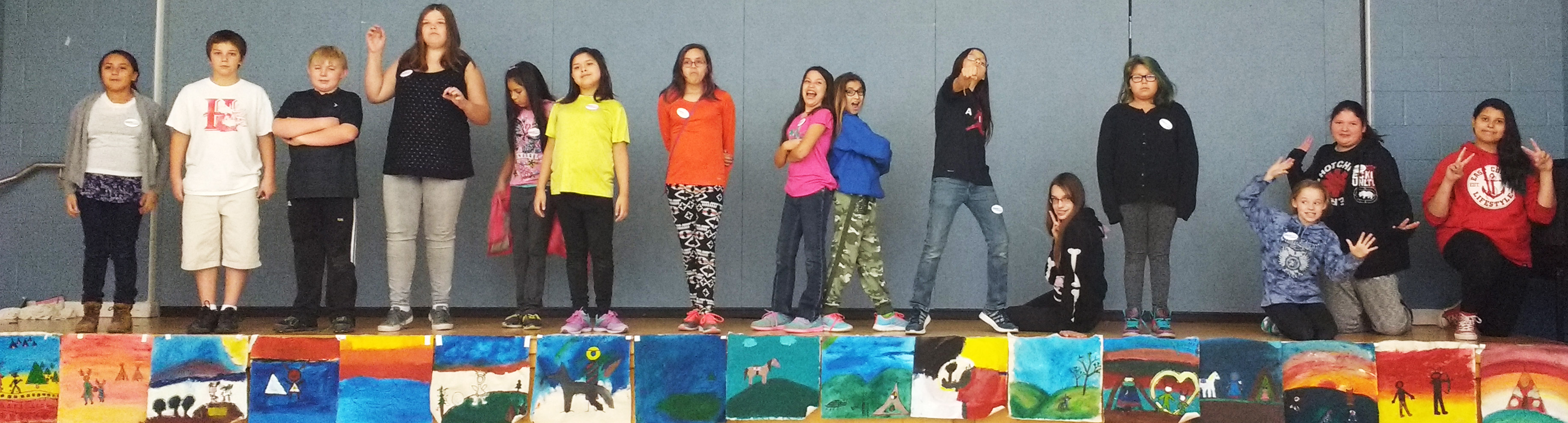 The grade sixes at Riverside EC proudly showcase their paintings. Photo by Trish Gibbon.