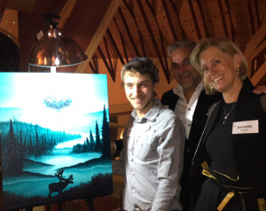 Tarik, Annette and Ricky next to a painting